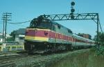 Going away shot of an Eastbound Massachusetts Bay Transportation Authority (MBTA) Push-Pull Commuter Train
