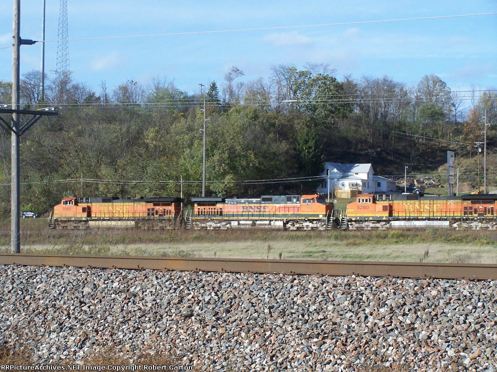 Sun-Splashed Locomotives Head West With a Load of Empty Hoppers