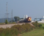 BNSF 8857 Brings a Short Load of Tankers into Town