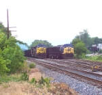 A pair of eastbound coal trains wait