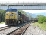 CSX 7734 runs around three parked coal trains