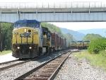 CSX 7734 runs around three parked coal trains