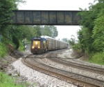 CSX 8087 passing under the NS bridge