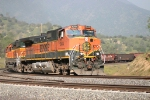 BNSF 1044 Leads a Manifest arround Walong