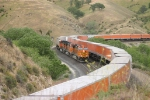 3 BNSF C44-9W's snake through the curves south of Illmon