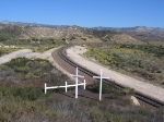Two crosses stand at the site of a deadly train derailment that happened in early Feb. 1996