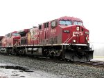 CP 9708 and sister 9638 lead Q381 through CP 382 on a rainy late April morning
