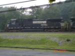 NS 9423 heads WB past The Station Inn