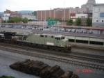 NS 7571 leads a freight EB thru town