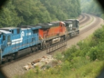 NS 9766, BNSF 7651 & NS (ex.CR) 8212 (dead in tow) head EB