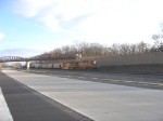 Westbound BNSF general freight passing under new Luce Line overpass