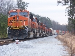 BNSF 7214 on the lead of X010