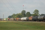 Southbound Kansas City Southern Railway Mixed Freight Train passes Yard Switchers