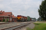 Southbound Kansas City Southern Railway Mixed Freight Train passes the former KCS Passenger Depot