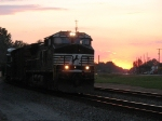 NS 9955 leading a plutonium shipment east at sunset as O57