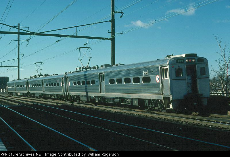 Southbound New Jersey Department of Transportation Commuter Train with Arrow III MU No. 1323 trailing departs the Station