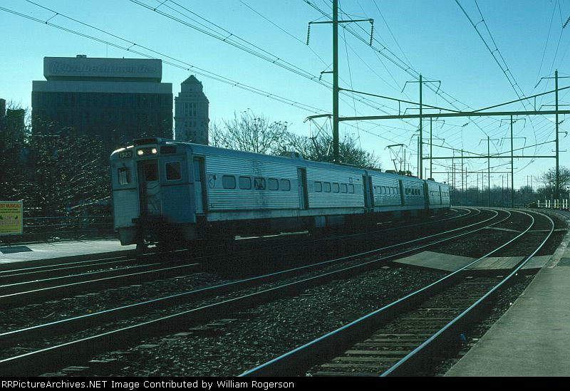 Northbound New Jersey Department of Transportation Commuter Train led by Arrow III MU No. 1323 arrives