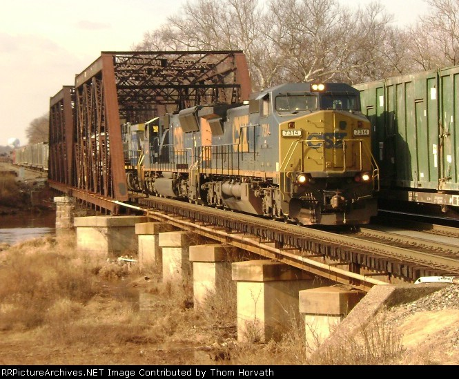 CSX Q300 passes a stopped Q707 east of Port Rdg Jct