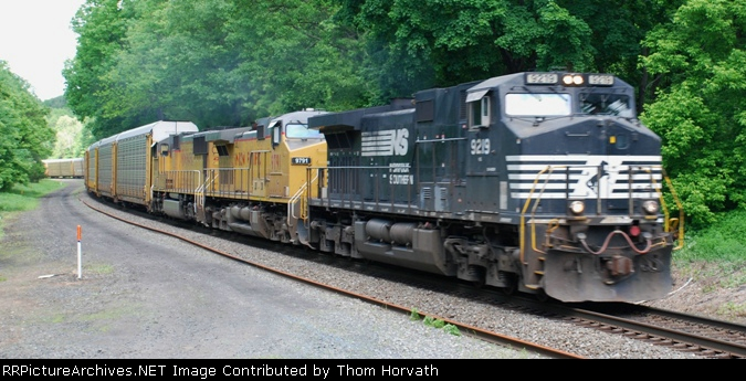 A late running NS 212 approaches the grade crossing at 12:29