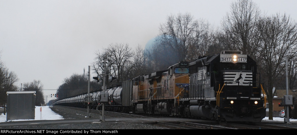 NS 3417 leads ethanol train 64E thru the 13th Street grade crossing