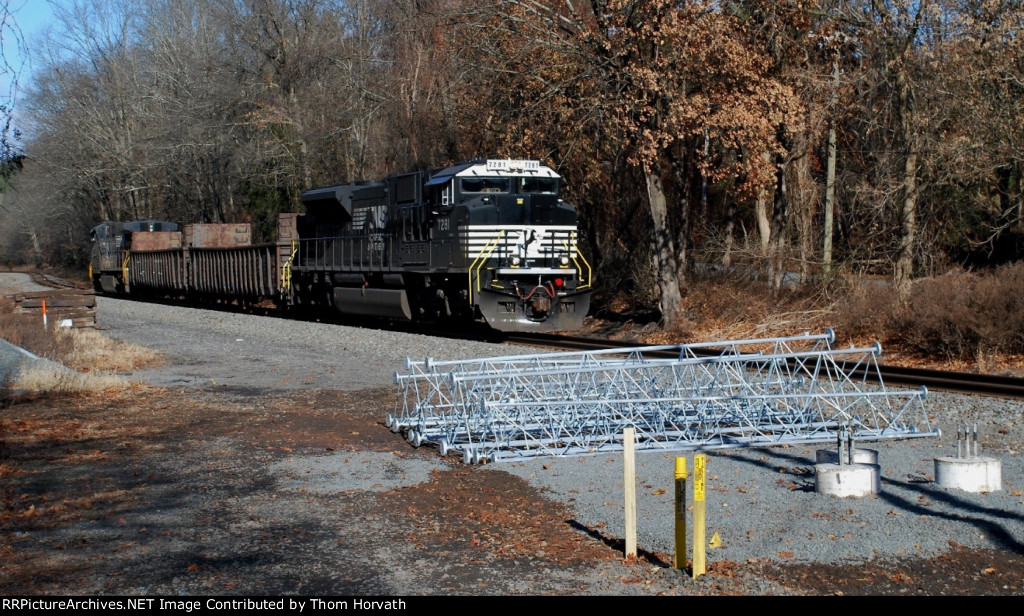 NS H76 is headed east past what might be PTC components @ MP 53