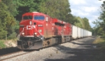 CP 39T approaches Main Street with a consist of 11 loaded hoppers