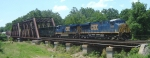 It is a little after 1 PM as CSX Q438 passes over the Raritan River