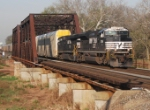 NS 212 heads east with its consist of intermodal and autoracks