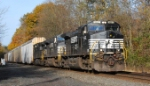 NS 212, with three C40-9Ws, makes its way east at MP 58