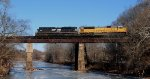 NS 21M is westbound as it crosses over a frozen Raritan River