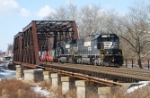 NS 24V brings its consist of COFCs over  a frozen Raritan River