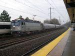 Amtrak AEM-7 914 Blows Past A Northbound NJ Transit Train In Metropark Station