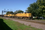 UP 6480 has company hoppers with basin coal in tow