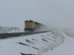 Brrrrrr  Cold day.UP 4292 WB East of Cheyenne Wy in snow.On Archer Hill