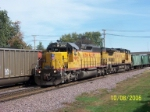 UP 2992 leads ballast train west