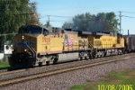 UP 5928 leads empty coal train west