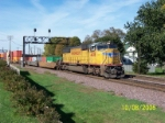 Solo engine UP 4478 leads short stack train eastbound