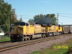 UP 7089 leads empty coal train west