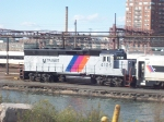 4105 coupled to a three car train