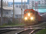 CN 6027 & CN 9581 passing New Westminster Quay with east-bound ballast train
