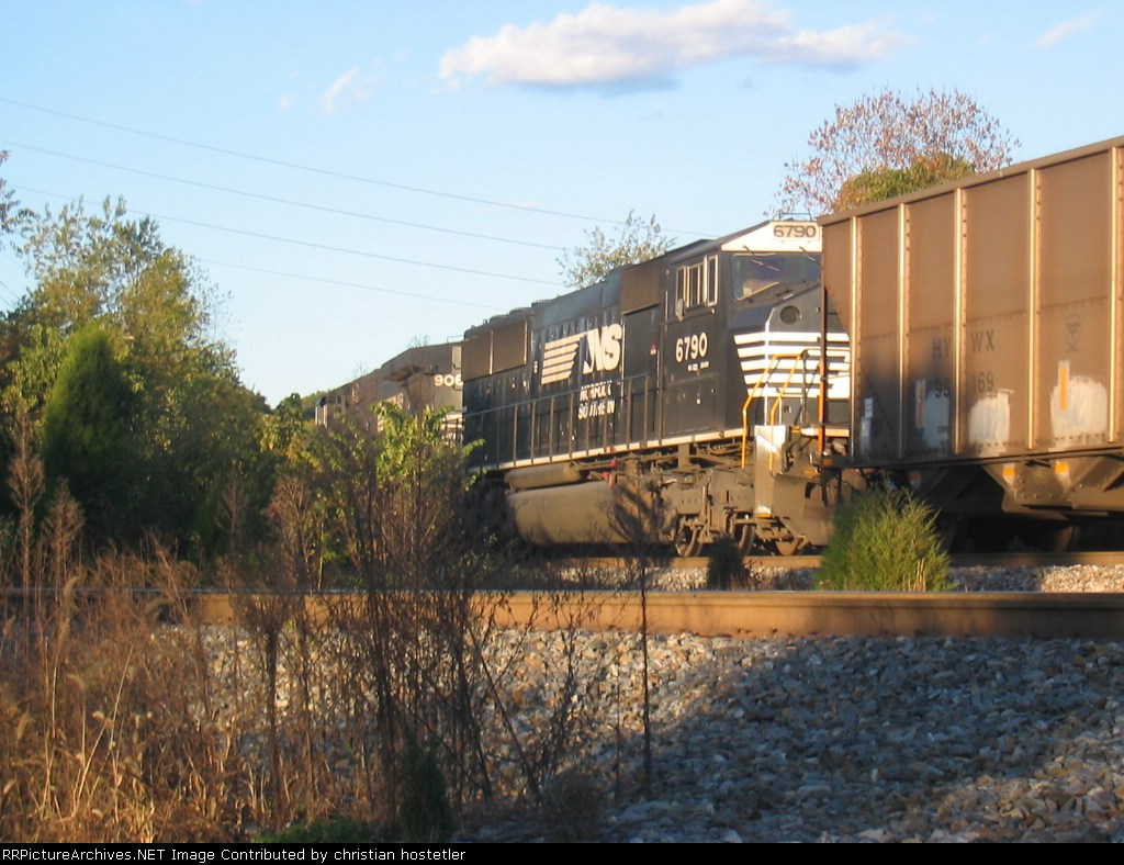 An NS train scoots past the CSX bridge and on by frisco yard