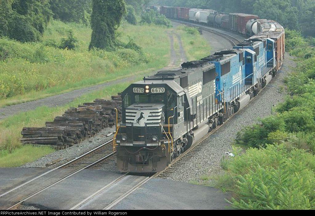 Norfolk Southern Railway Mixed Freight Train enters Enola Yard with EMD SD60 No. 6670, Ex Conrail SD60I No. 6735 and Ex Conrail SD60I 6719 providing power