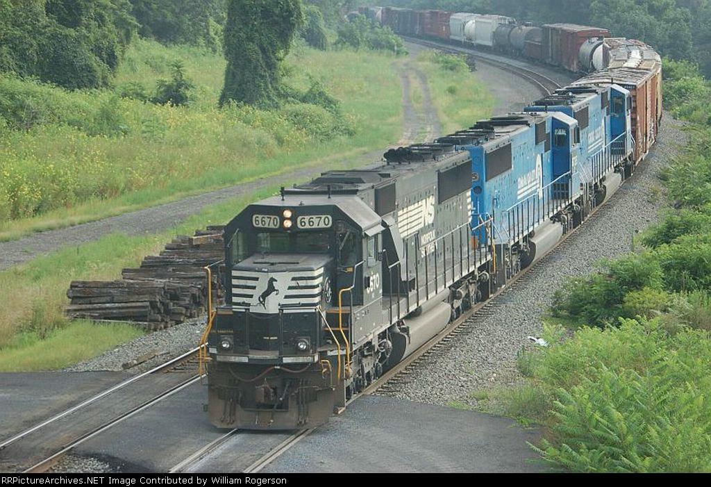 Three EMD SD60's lead a Norfolk Southern Railway Mixed Freight Train into Enola Yard