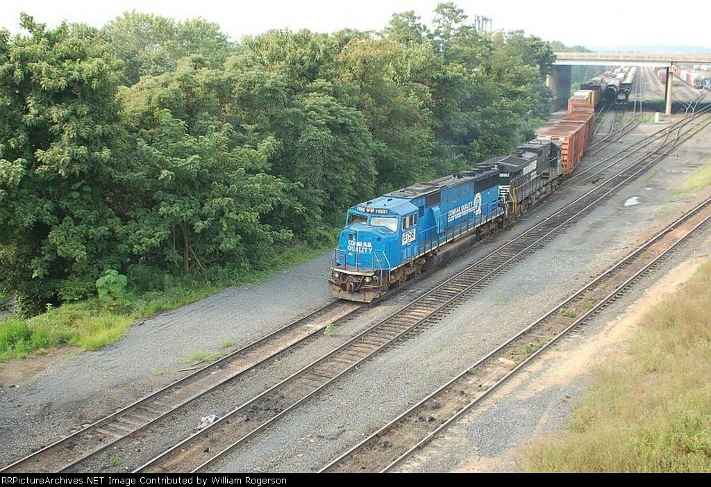 A Norfolk Southern Railway Mixed Freight Train departs Enola Yard with Ex Conrail EMD SD60I No. 6758 and GE C40-9 No. 8882 providing power