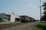 Norfolk Southern Railway EMD SD70M No. 2627 leads a string of gondolas Westbound