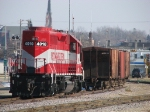 WSOR 4010 sits with some ballast cars