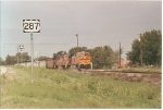 BNSF 5986 rolls south through Lea Lakes, Tx next to Hwy 287