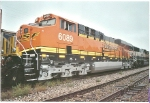 BNSF 6089 rear DPU next to BNSF 6102 on a cold blustery rainy day in Denver, Co.