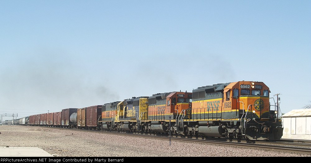 BNSF 6982, 7132, 6352, and 341 Take Mixed Freight East