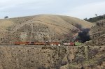 BNSF 4140, 4735, 4657, and 775 Exiting Tunnel 5 While Climbing to Tehachapi Loop and Then to the Summit at the Town of Tehachapi.